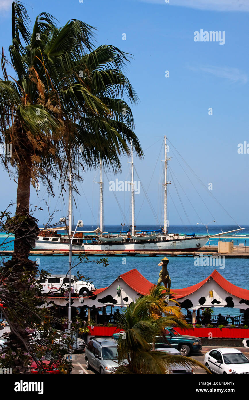 West Indies Aruba Oranjestadt Bar Cafe The Paddock Dino on the roof harbour - Stock Image