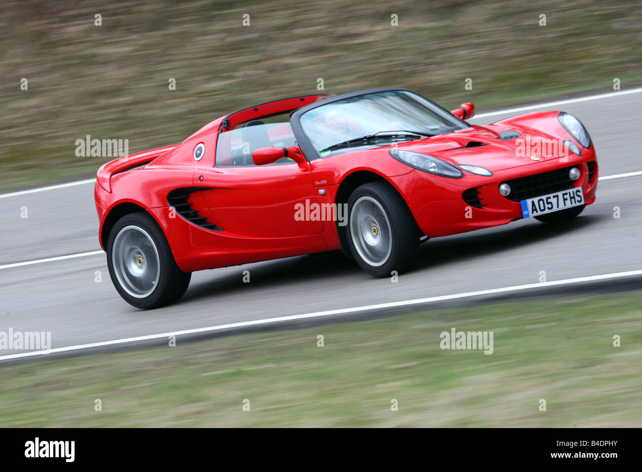 https://c8.alamy.com/comp/B4DPHY/lotus-elise-sc-model-year-2008-red-driving-diagonal-from-the-front-B4DPHY.jpg