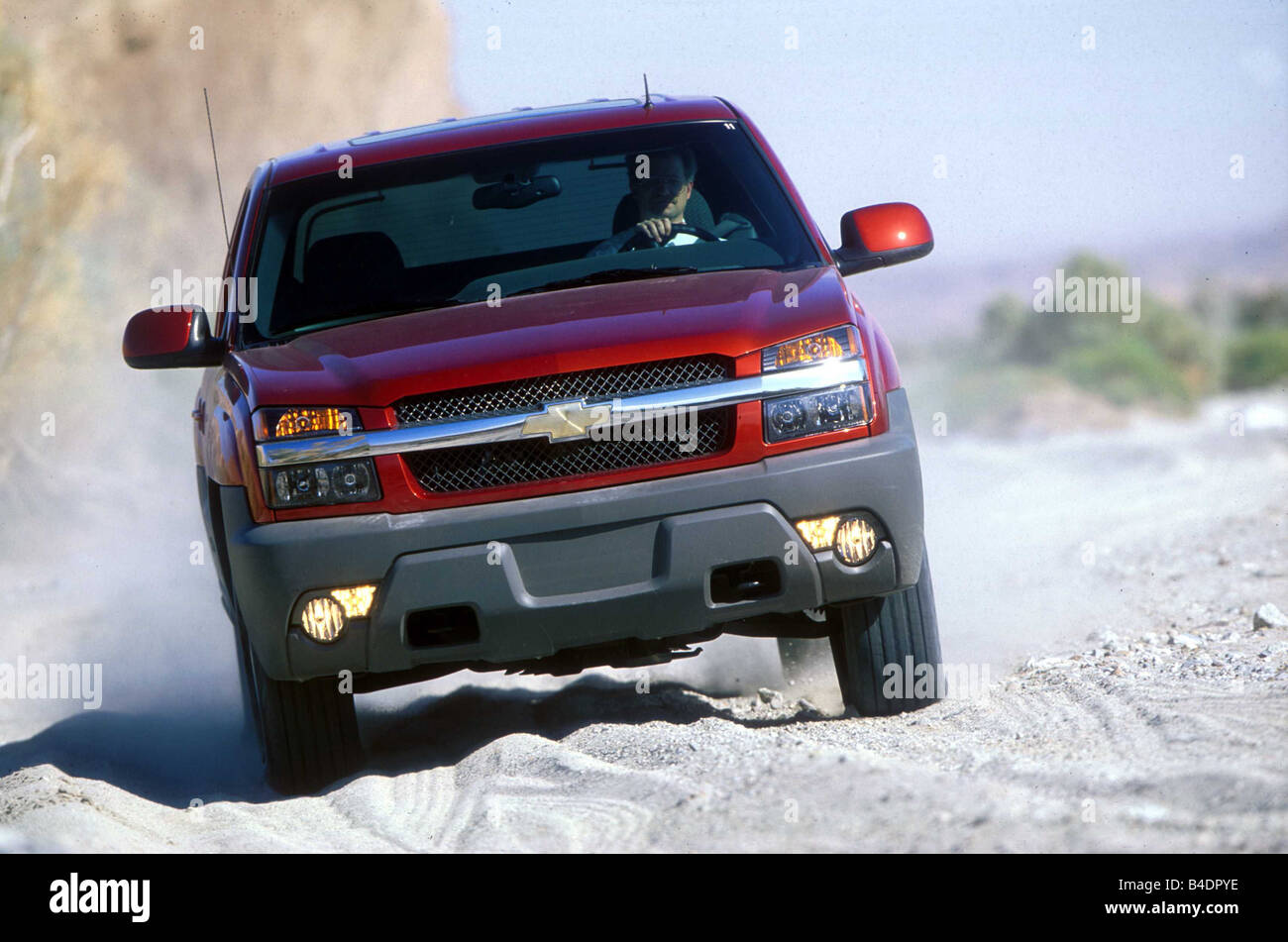 Car, Chevrolet Avalanche 1500 4WD, cross country vehicle, model year 2001-, red, ruby colored, frontal view, offroad, - Stock Image
