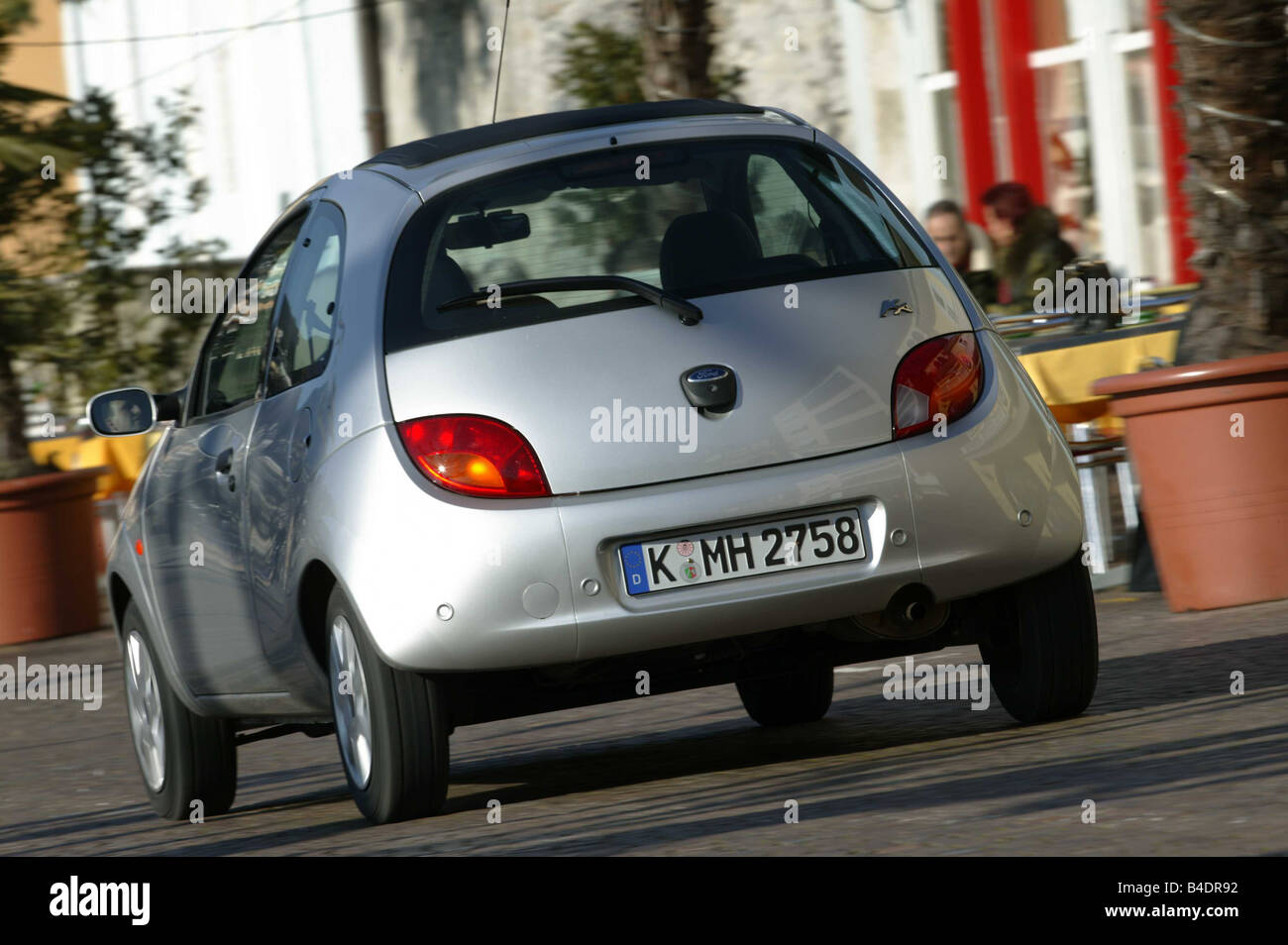 Car Ford Ka Miniapprox S Model Year  Limousine Silver Diagonal From The Back Rear View Driving City