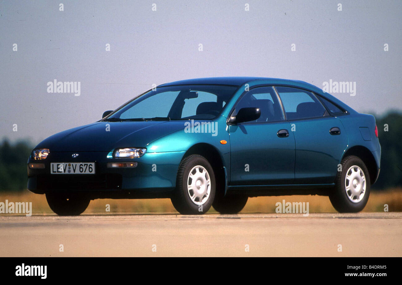 Mazda 323 stock photos mazda 323 stock images alamy car mazda 323 lower middle sized class limousine model year 1998 altavistaventures Choice Image