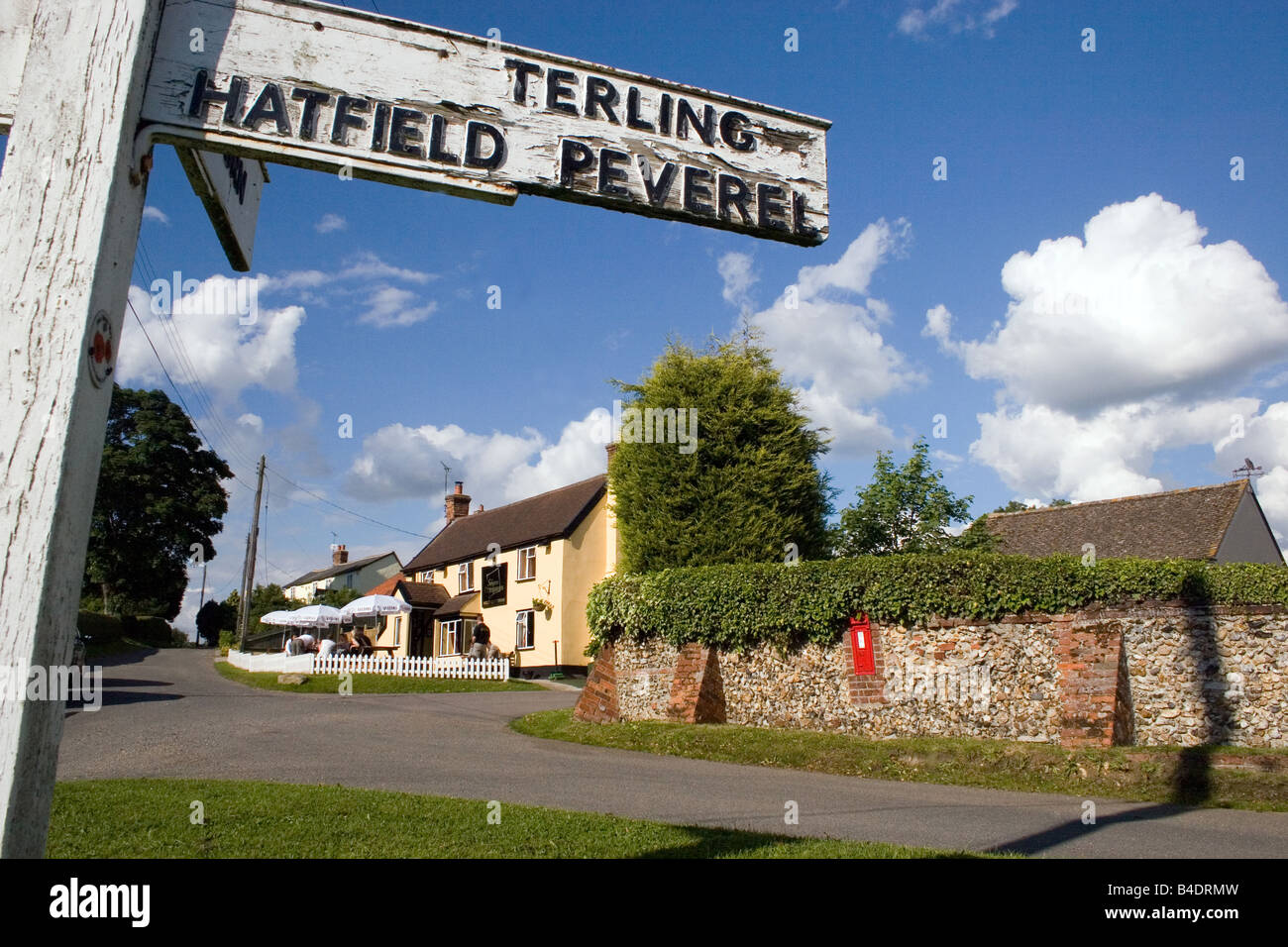 village signpost and the Square Compass pub Fairstead Essex England - Stock Image
