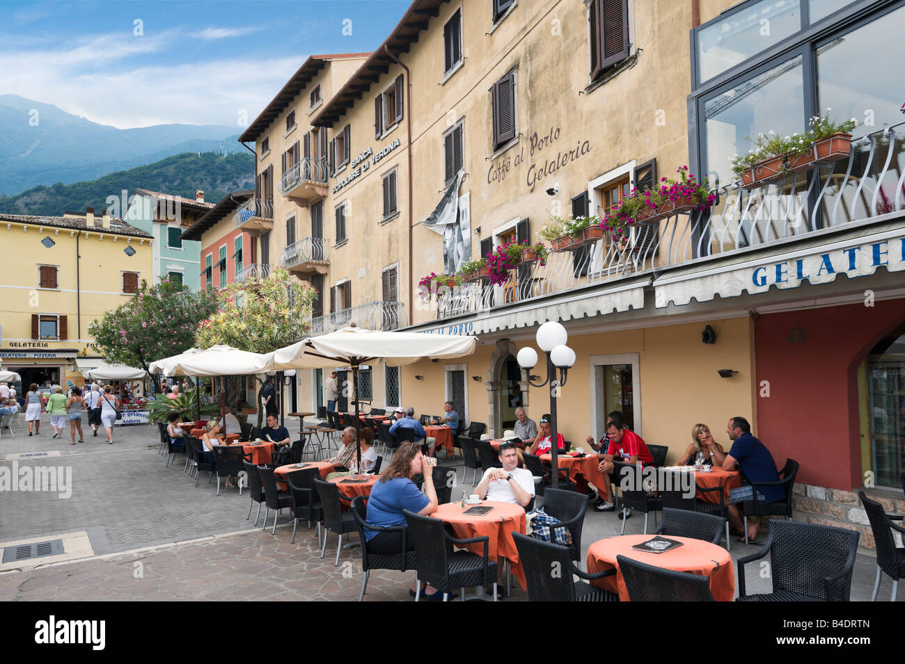 Cafe on the harbourfront in the old town, Malcesine, Lake Garda, Italy Stock Photo