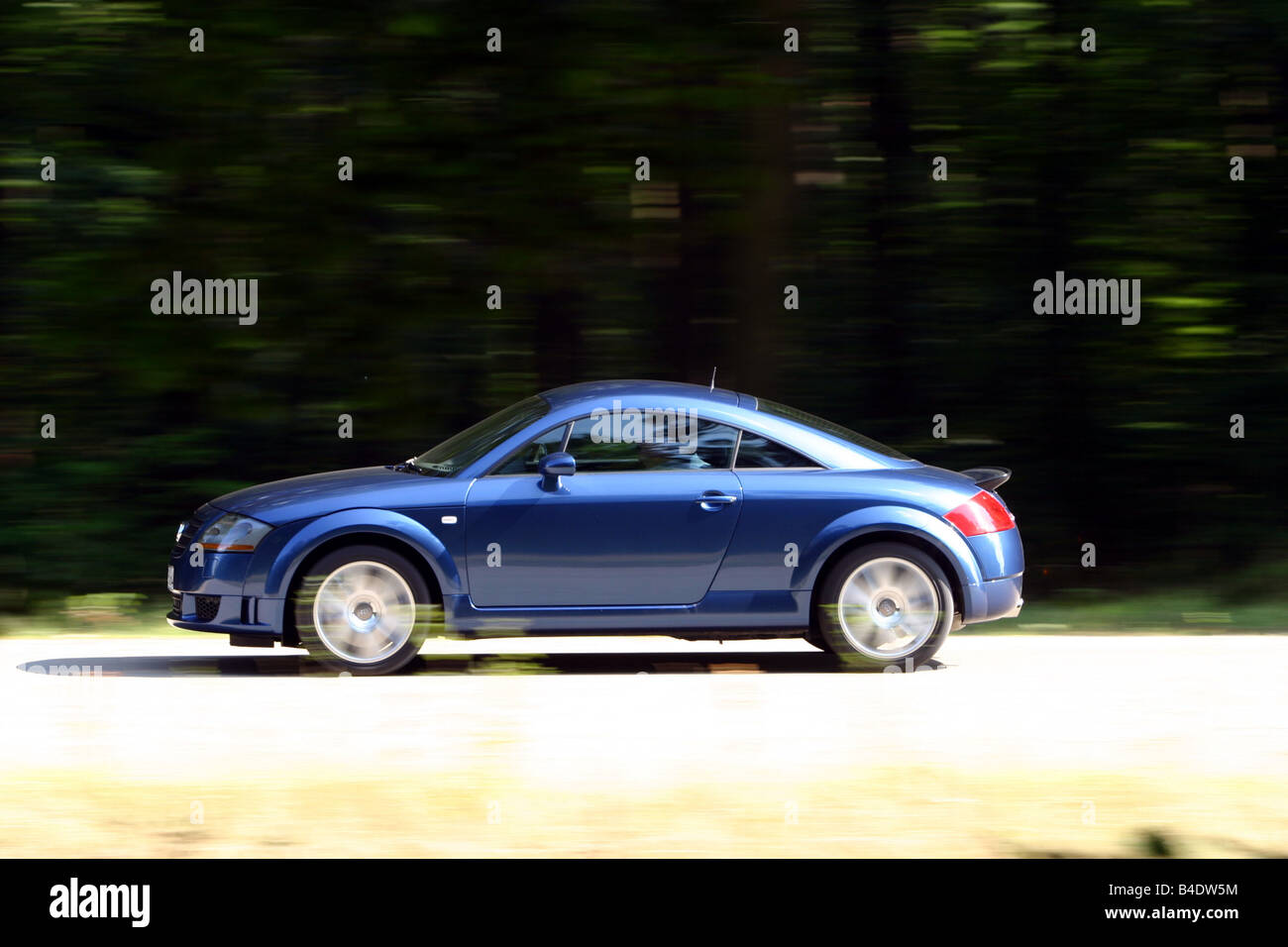 Car, Audi TT 3.2, coupe, roadster, model year 2003-, blue moving, country road, side view Stock Photo