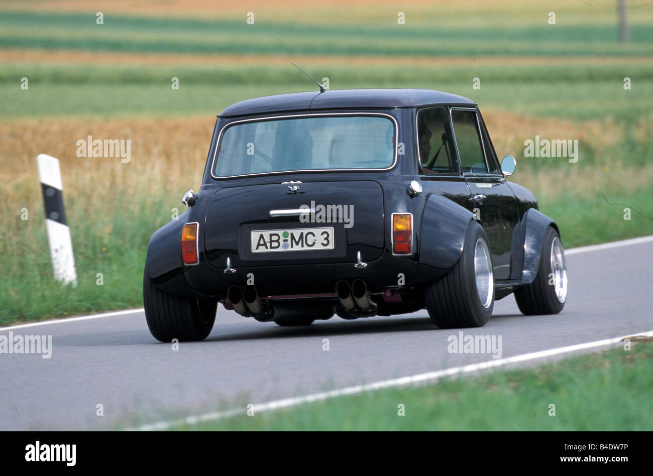 Car, Mini MKII Cooper, coupe/Coupe, Miniapprox.s, black, model year 1990-2001, Tuning, diagonal from the back, rear - Stock Image