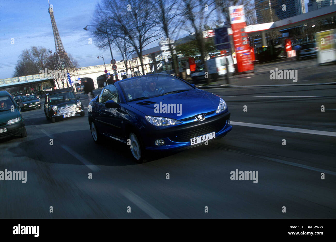Car, Peugeot 206 CC, Convertible, model year 2000-, blue, open top, driving, City, diagonal from the front, Paris Stock Photo