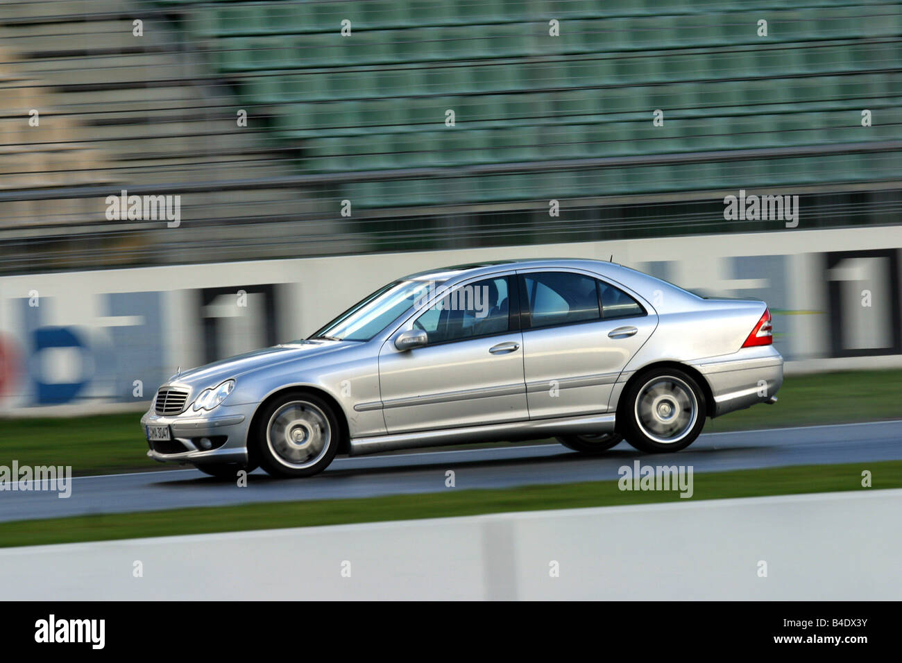 Car, Mercedes C 30 CDI AMG, model year 2002, silver, medium class, Tuning, 231 PS, driving, race track, test track, - Stock Image