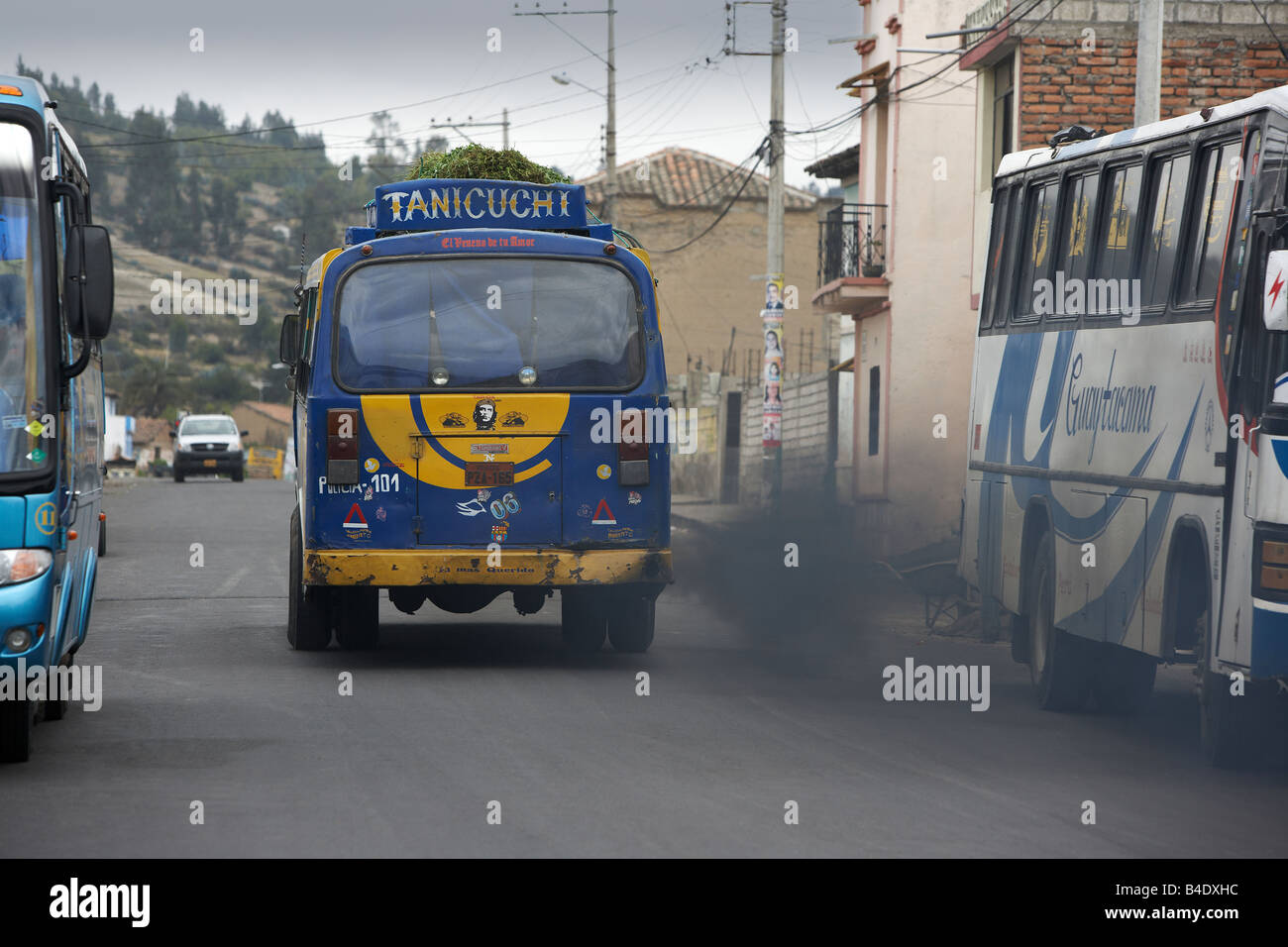 Bus polluting the streets by Saquisili Market, Ecuador - Stock Image