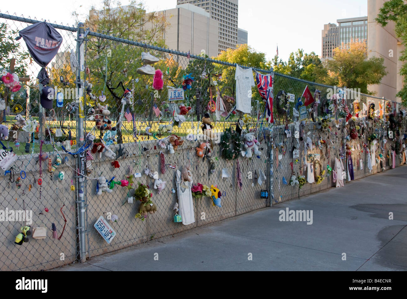 Oklahoma City, Oklahoma, USA. OKC National Memorial Mementos on Fence, Toys, Dolls. Clothing of those lost in the - Stock Image