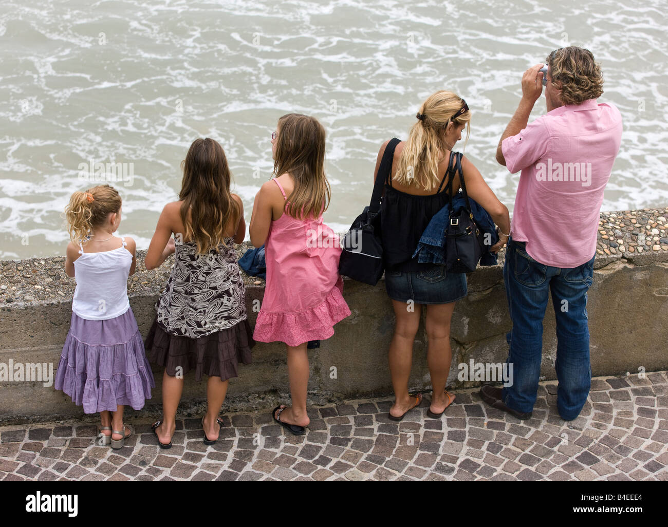 A French family with three children. Larger French families in the early 21st century are increasing France's - Stock Image
