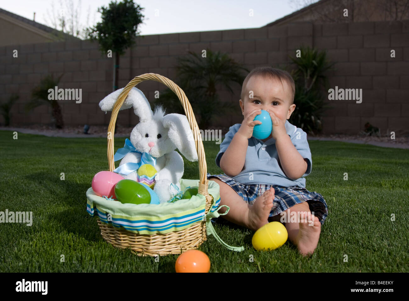 A cute playfull 1 year old boy playing with easter eggs from his a cute playfull 1 year old boy playing with easter eggs from his easter basket with negle Choice Image