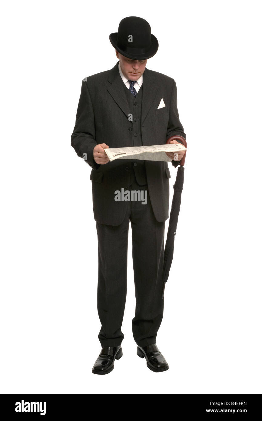 Businessman in pinstripe suit and traditional bowler hat with umbrella reading the financial newspaper Stock Photo