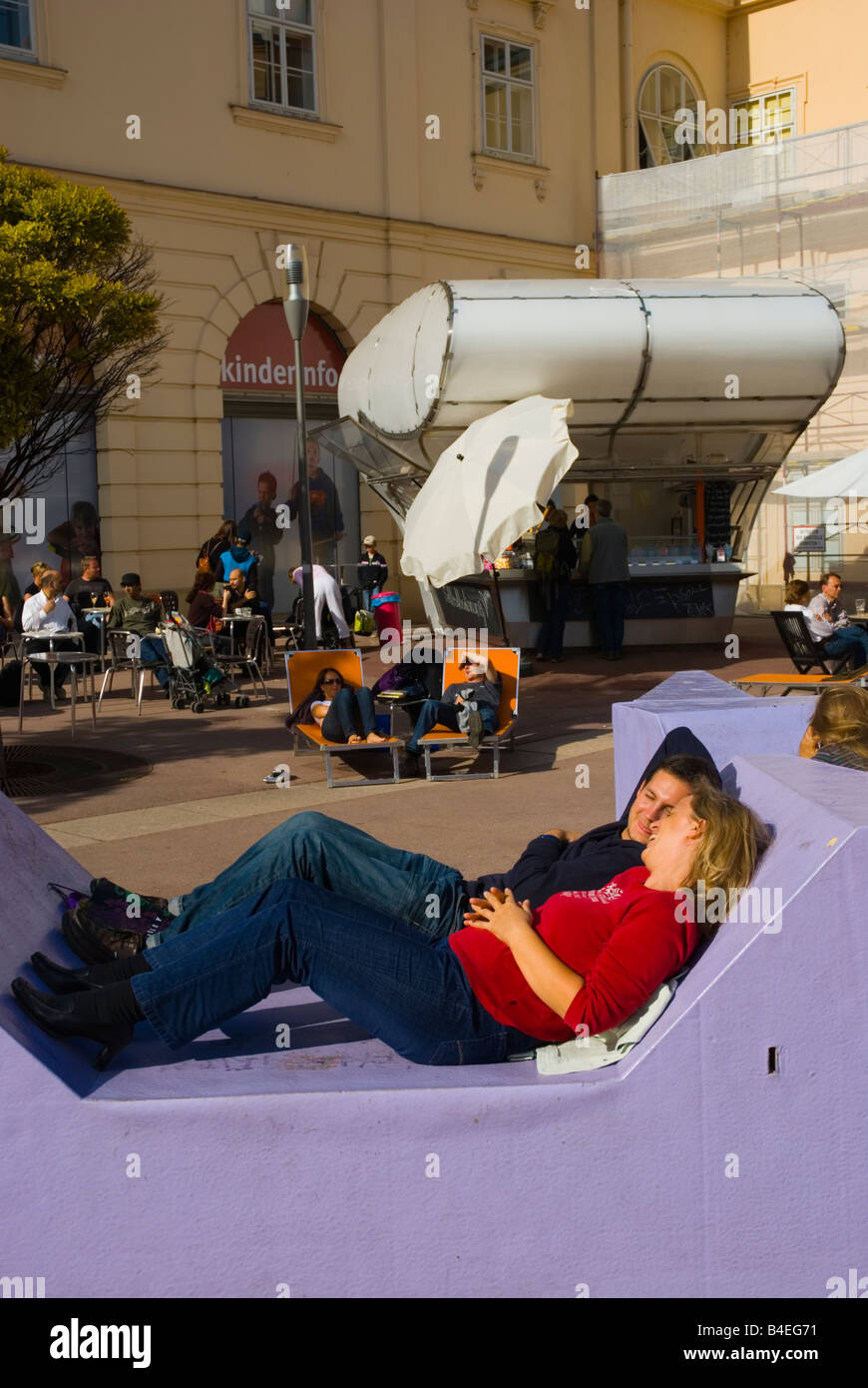 People relaxing in Museums Quartier district in central Vienna Austria Europe - Stock Image