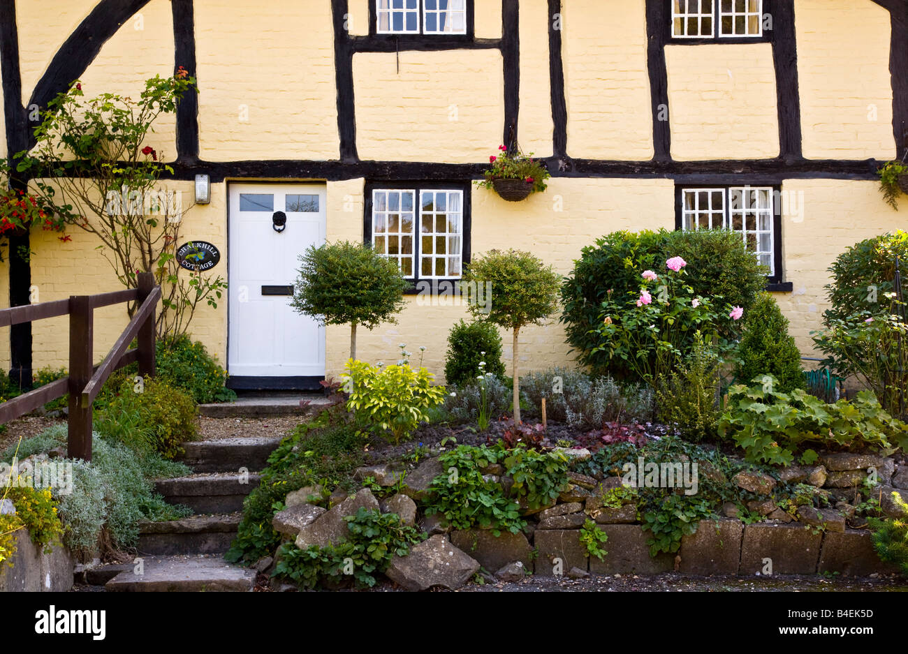Front view close-up of a typical English timber framed whitewashed Tudor rural country cottage in All Cannings, - Stock Image