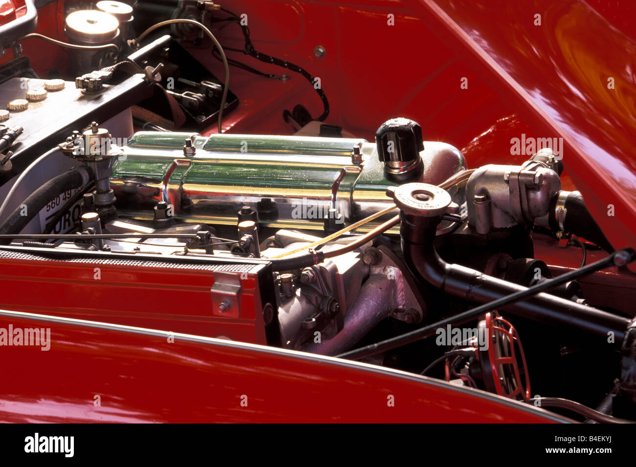 Car, Triumph TR 4, vintage car, model year 1962, 1960s, sixties, red, convertible, engine compartment, engine , - Stock Image