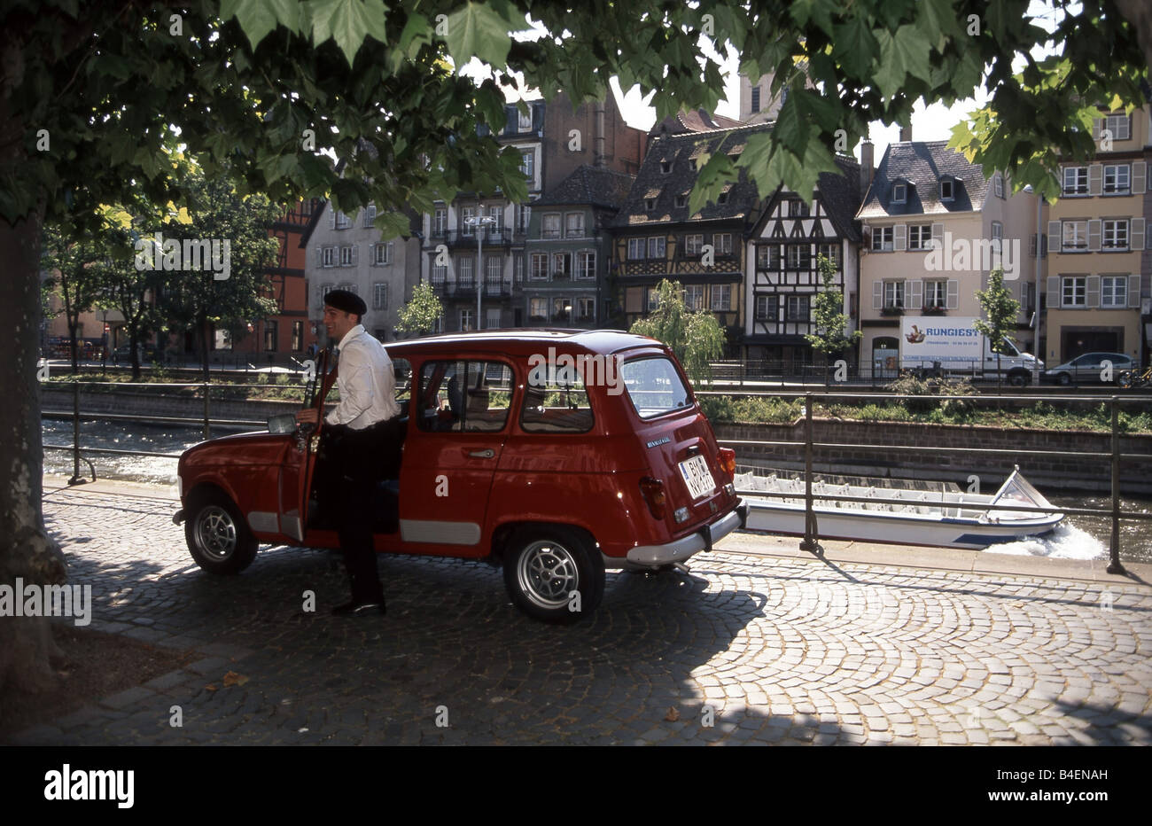 Car, Renault 4, old car, red, standing, side view, city, 'mit Franzose', photographer: Hans Dieter Seufert - Stock Image