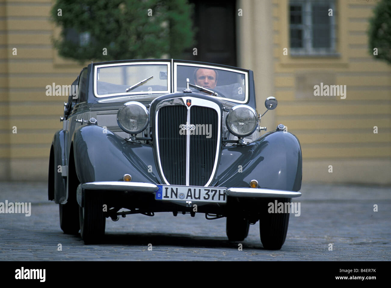 Audi 225 convertible, model year 1933-1938, grey, driving, diagonal front, front view, city, landscape, scenery Stock Photo