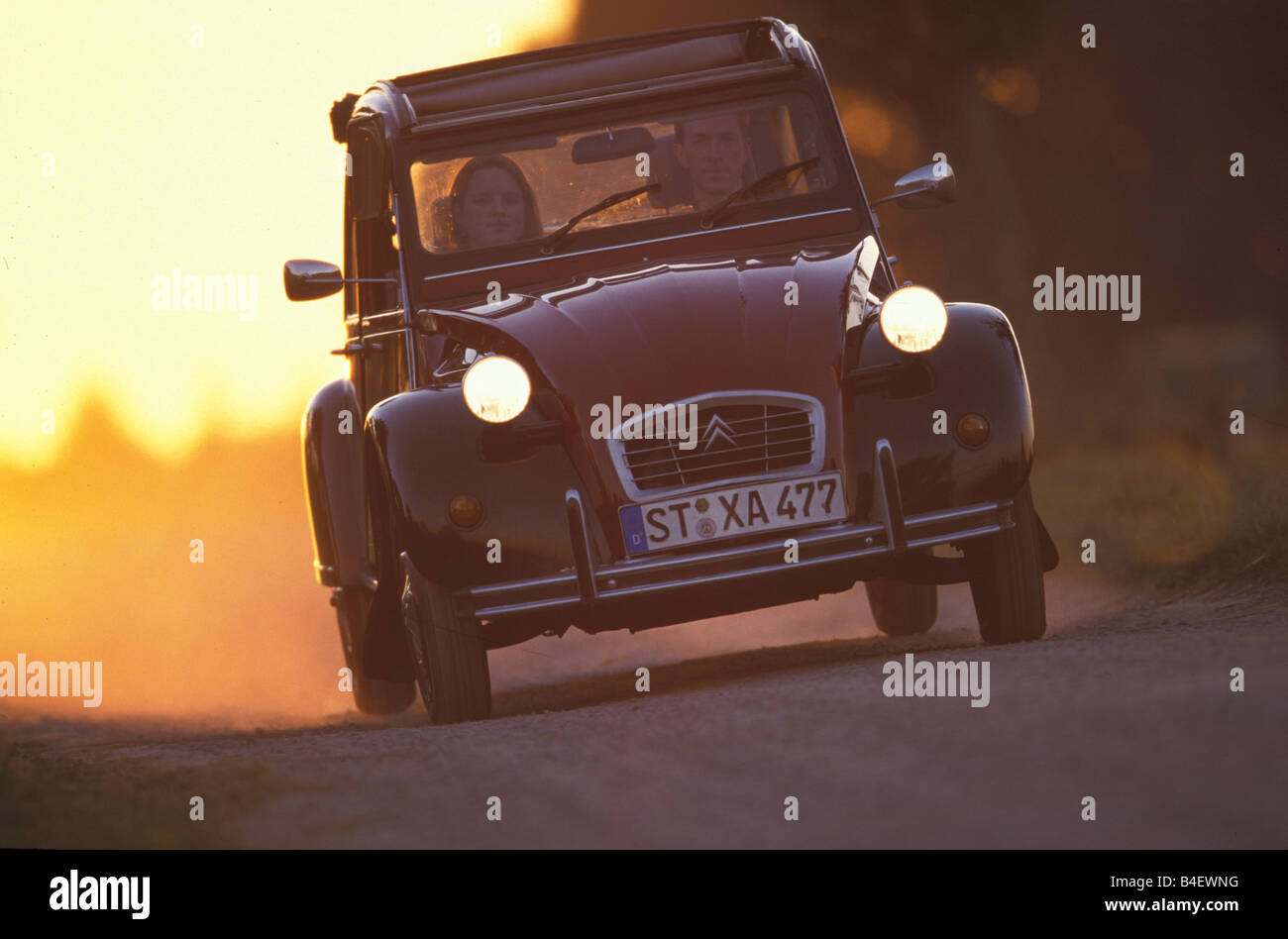 Car, Citroen 2CV Charleston, sedan, model year 1980-1989, old car, red-black, driving, road, country road, diagonal Stock Photo