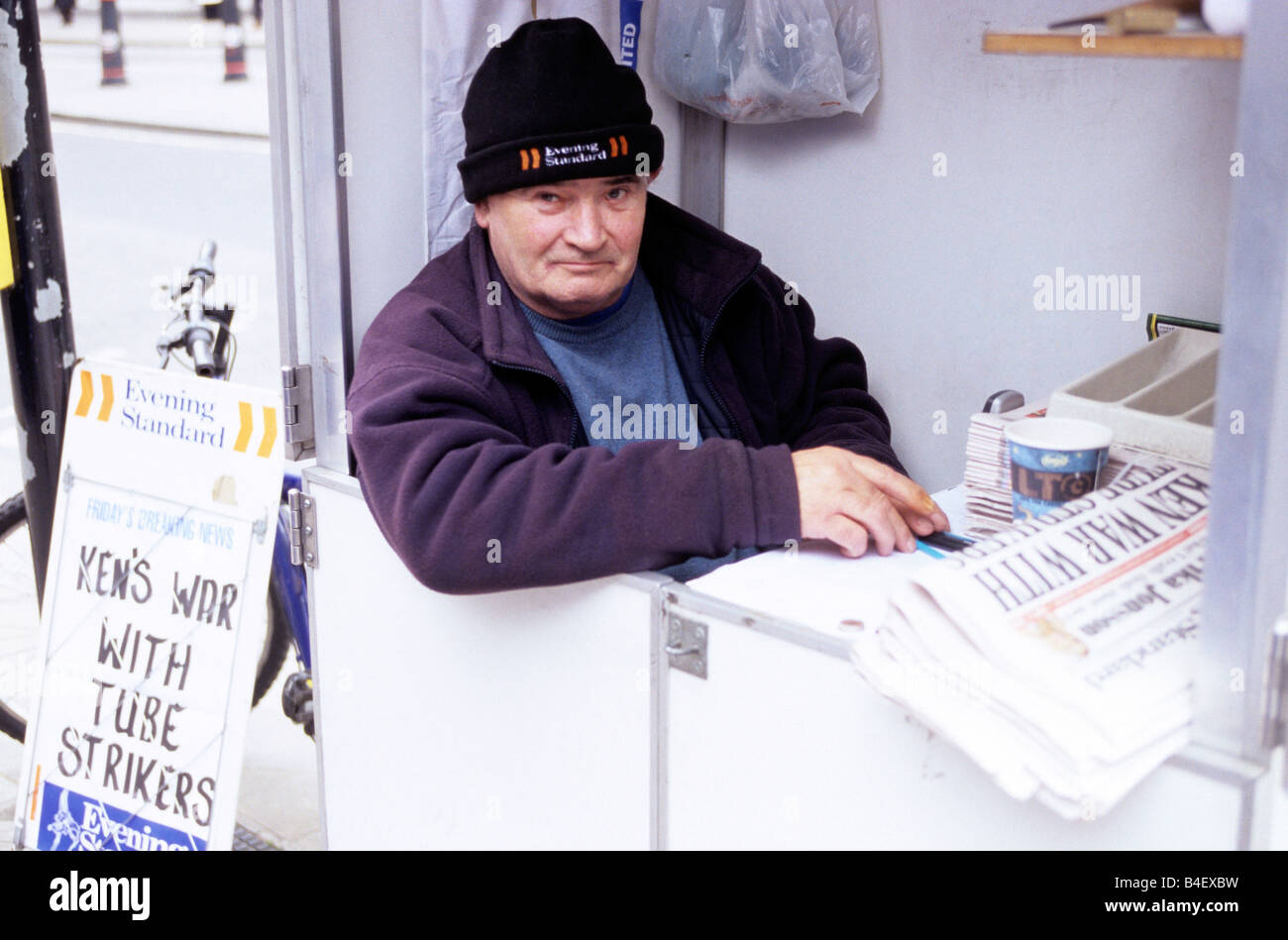 A man selling newspapers in London. Stock Photo