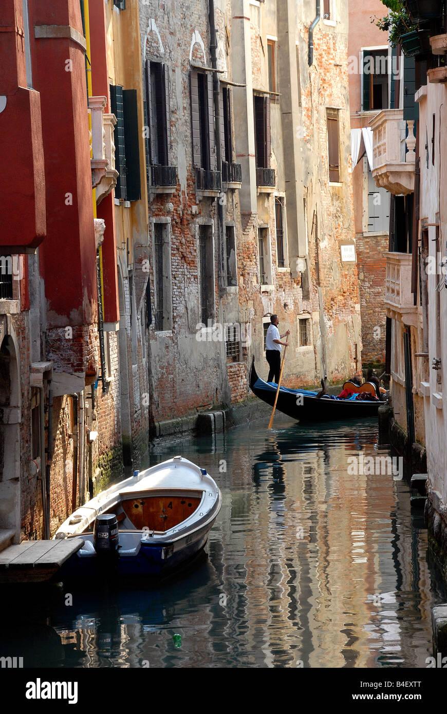 Gondola in small canal Venice Italy - Stock Image