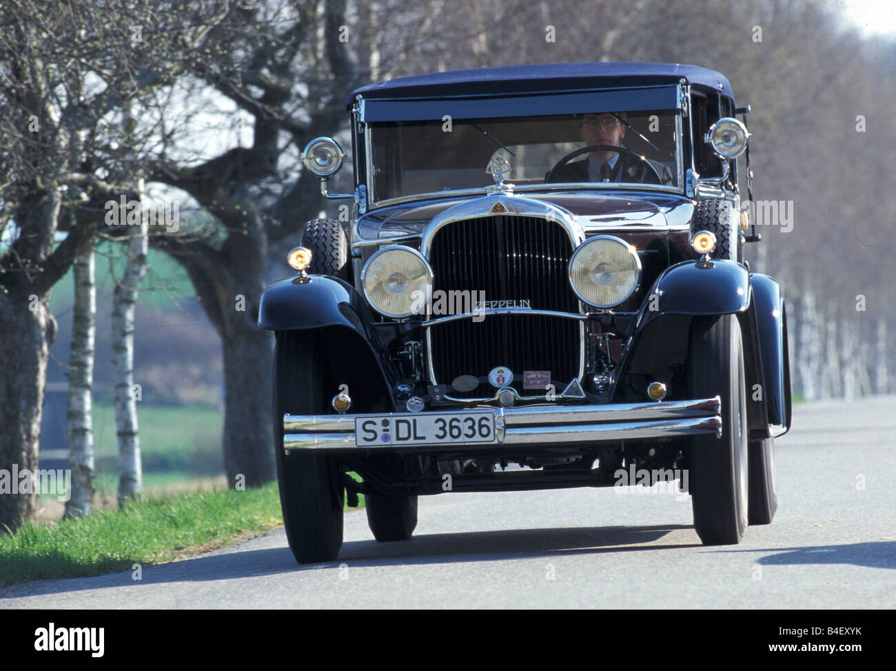 Car, Maybach Zeppelin, vintage car, 1930s, thirties, black,  driving, diagonal front, front view, road, country - Stock Image