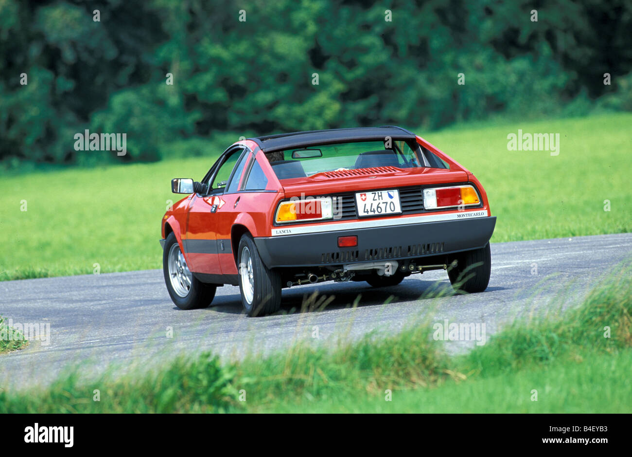 Car, Lancia Beta Montecarlo, old car, red, Coupé, Coupe, sports car, 1970s, seventies,  1980s, eighties, driving, Stock Photo