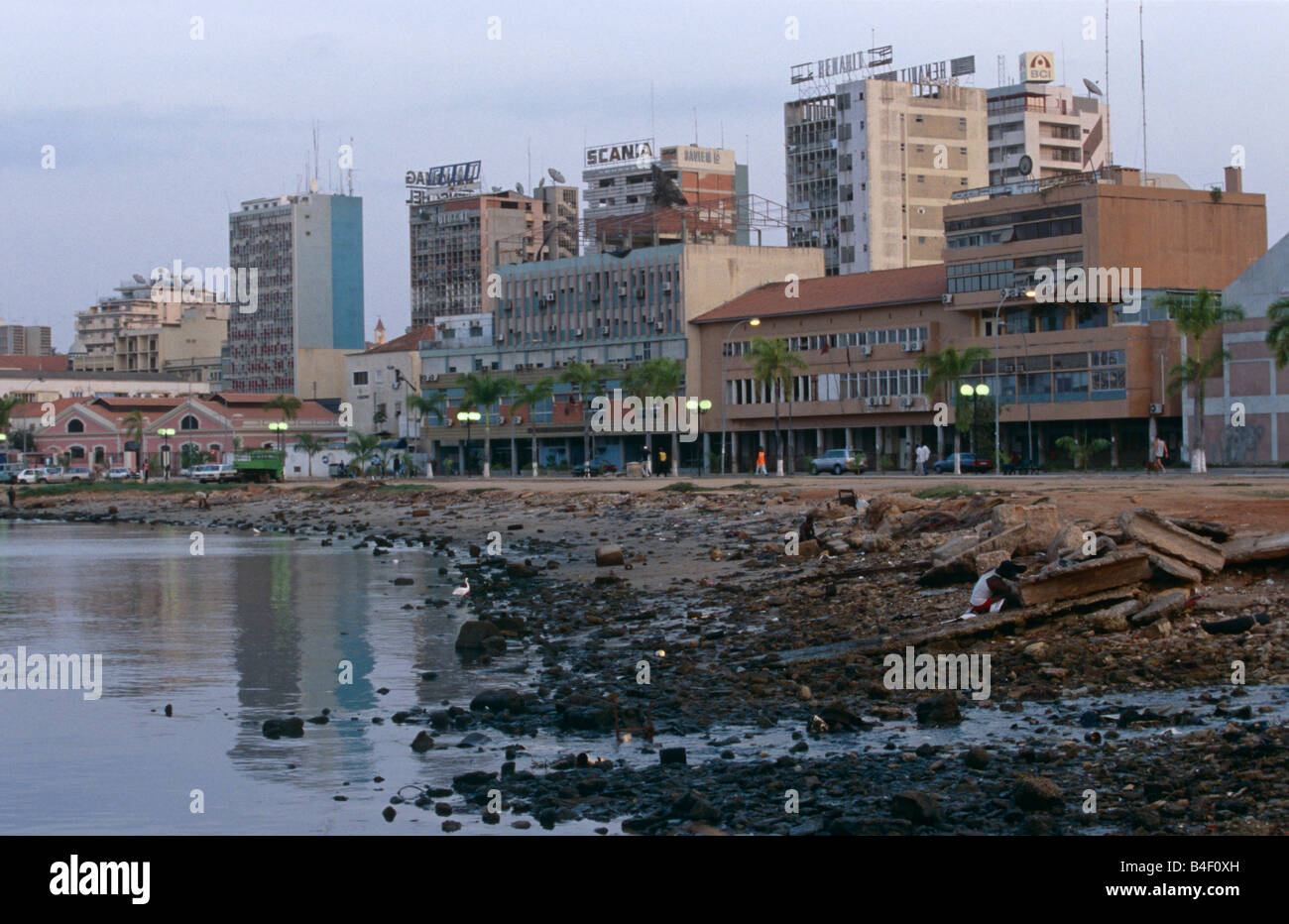 Polluted beach and tower block city skyline, Luanda, Angola, Africa - Stock Image