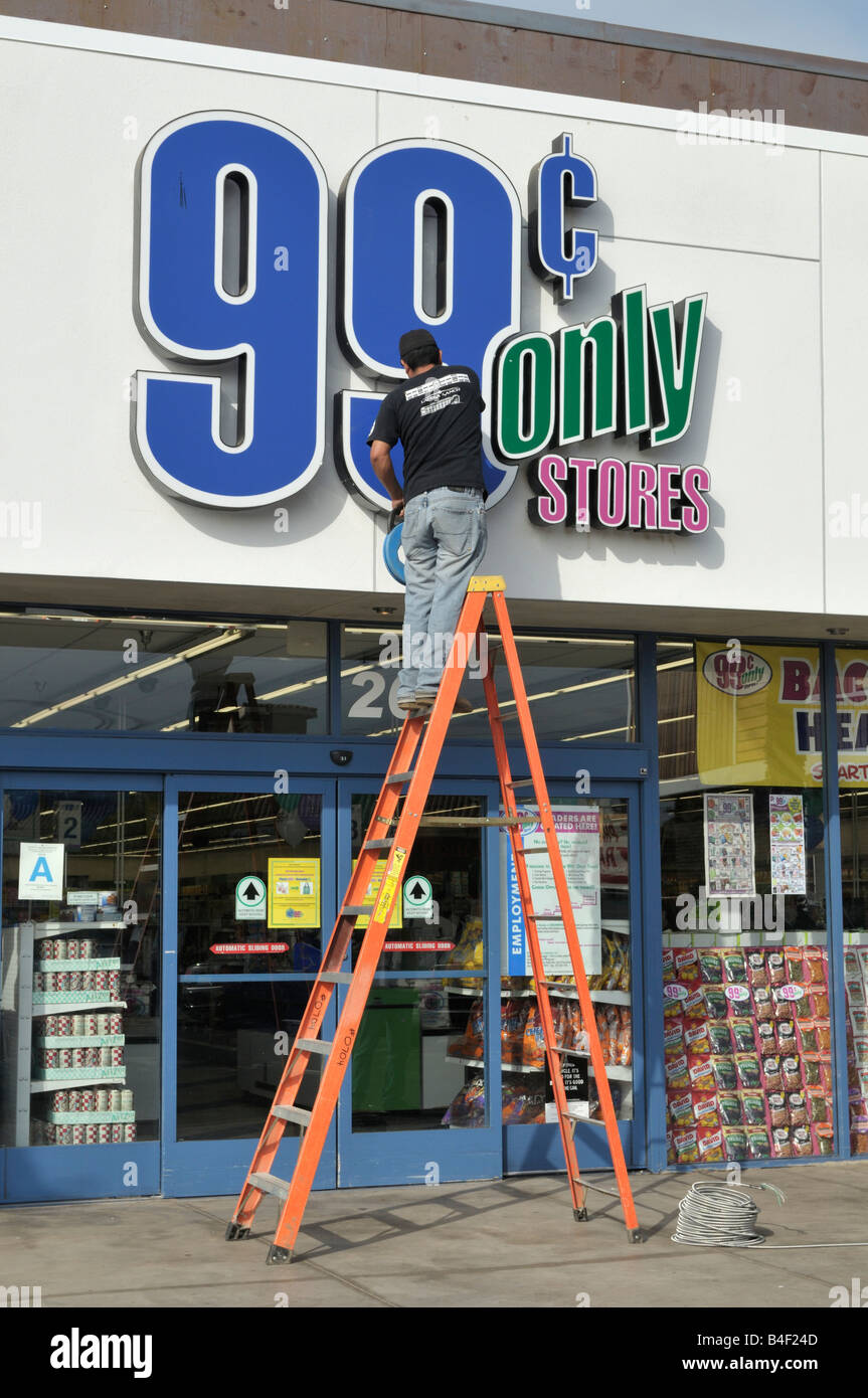 Fixing The Electrical System In Sign Outside A 99 Cents Only Store