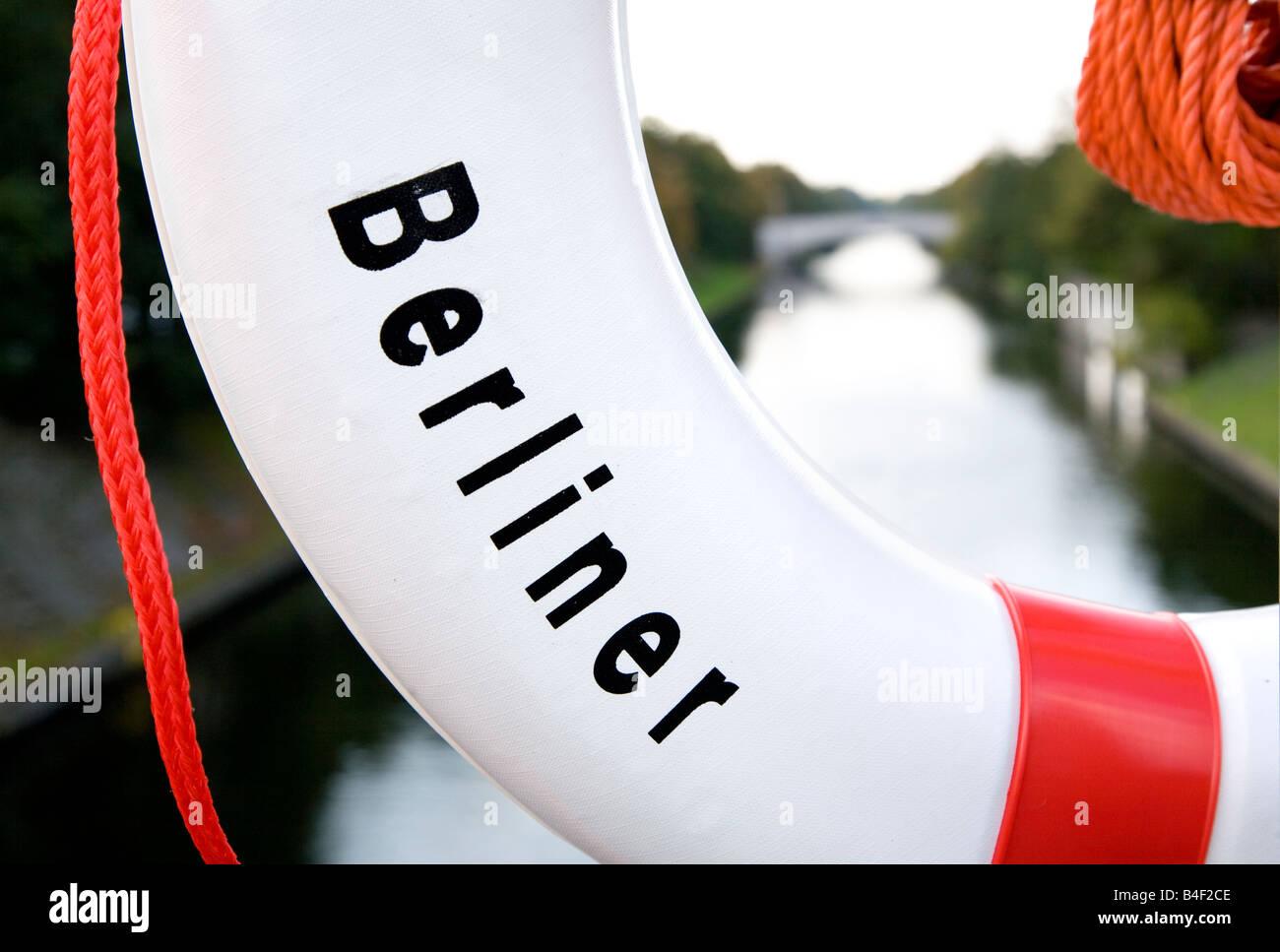 Lifering or Lifebouy with Berliner written on it alongside a Berlin Canal - Stock Image