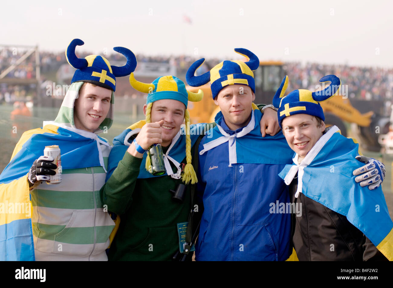 swedish fans spectators sweden nation pride flag yellow and blue at sporting event viking helmet helmets good natured - Stock Image