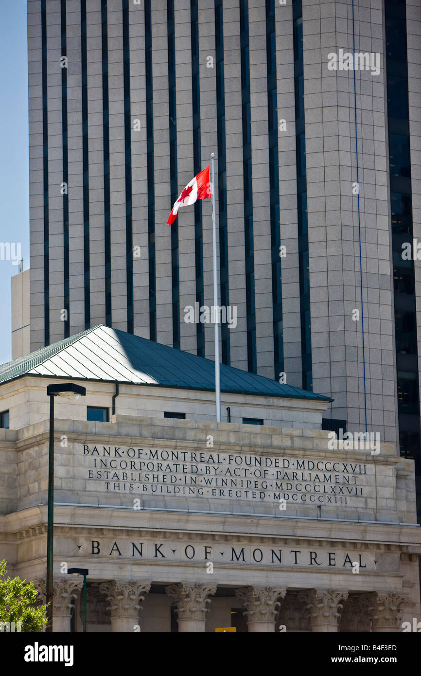 Facade of the Bank of Montreal Building backdropped by a modern skyscraper, Winnipeg Square, City of Winnipeg, Manitoba, - Stock Image