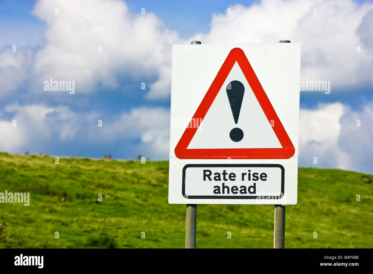 Financial concept warning of interest rate rise ahead sign England UK - Stock Image