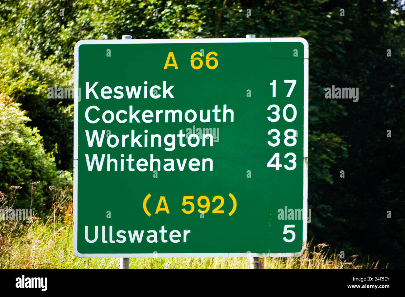 Green UK 'A' road sign on the A66 route with distance information, England, UK - Stock Image