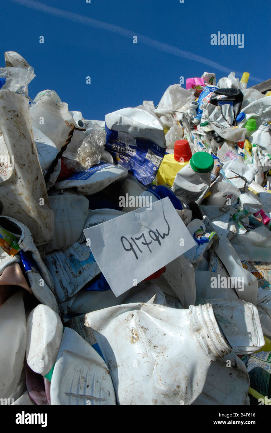 Bales of waste plastic bottles awaiting recycling at a reprocessing plant - Stock Image