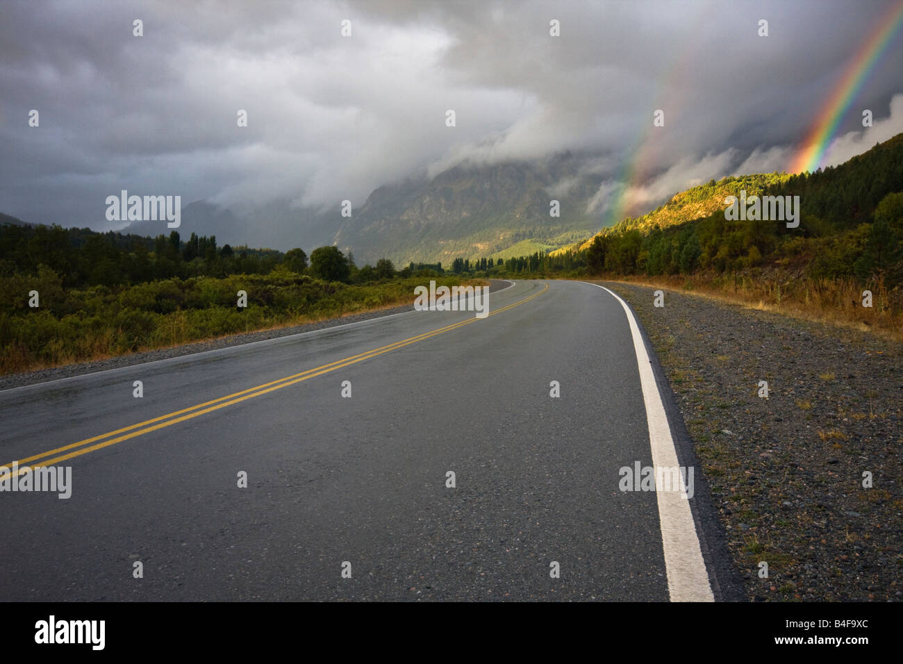 Beautiful double rainbow after a storm at route 254, El Bolson, Patagonia, Argentina. - Stock Image