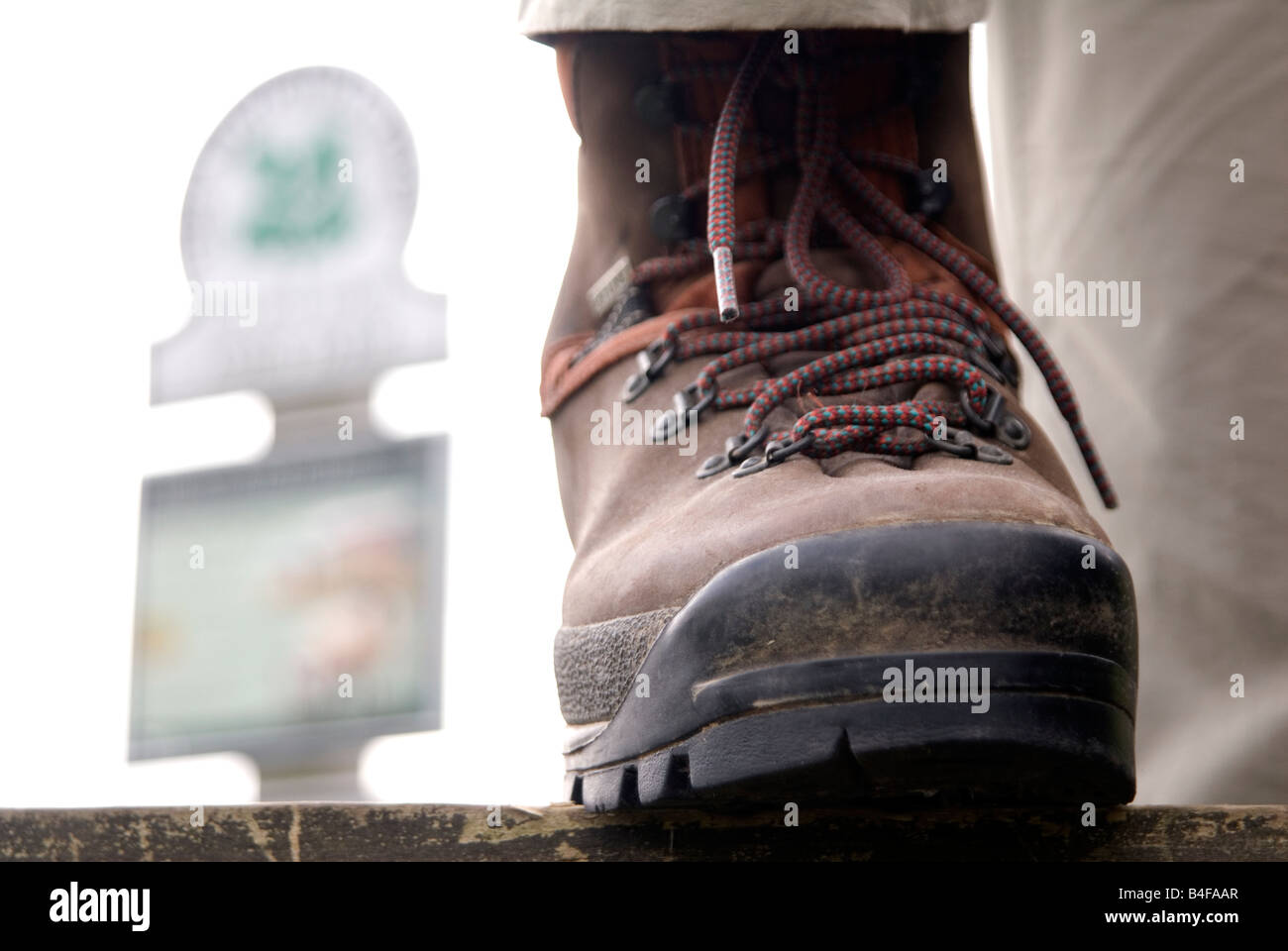Walking boot & sign post in the Peak District National Park Derbyshire England UK GB - Stock Image