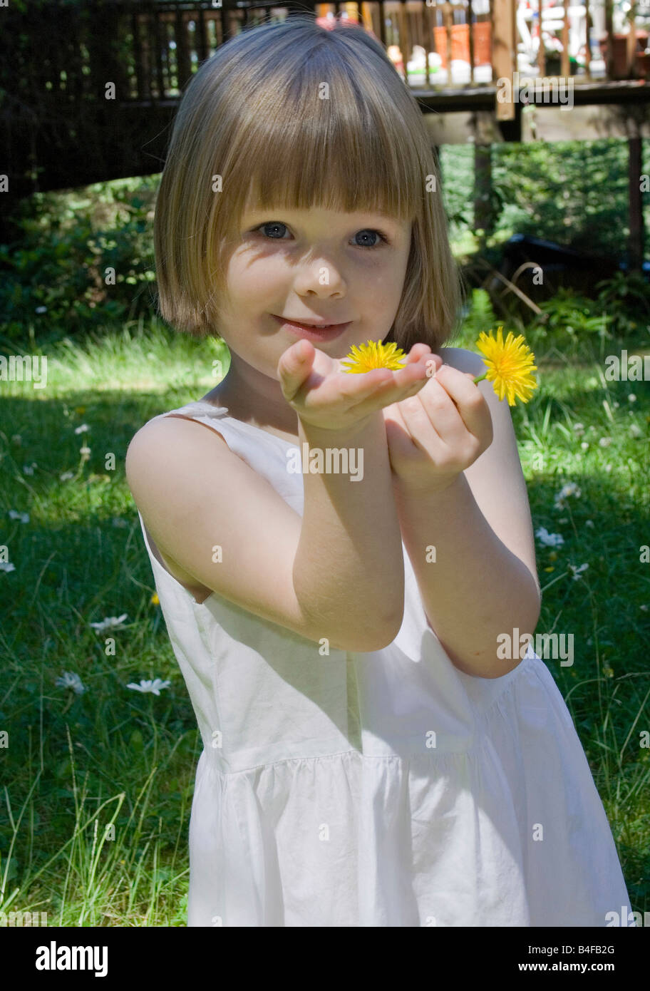 Young Girl In White Dress Summer Or Springtime Giving A Bright