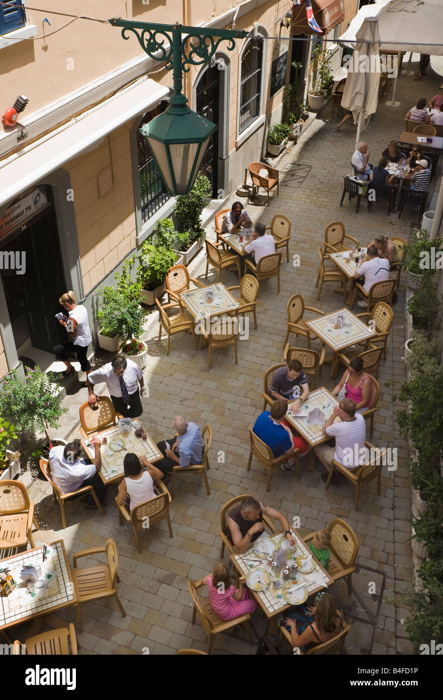 Gibraltar Diners and tables on street outside Temptations restaurant - Stock Image