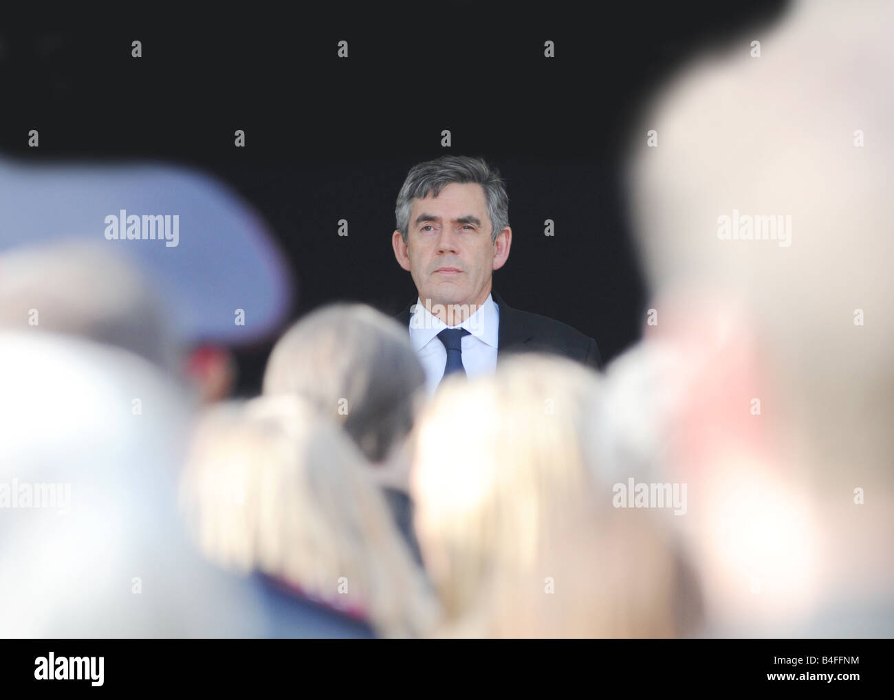the prime minister gordon brown addressing a memorial service to a police officer murdered on duty - Stock Image