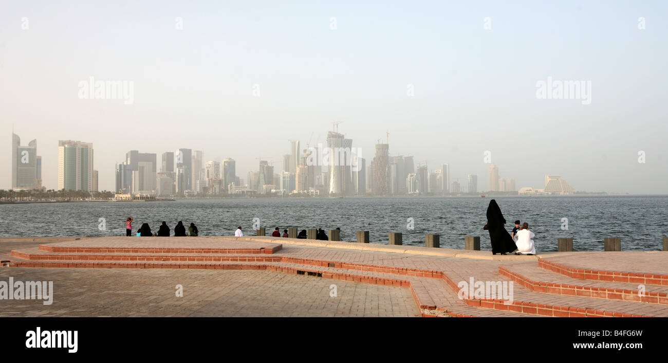 Families relaxing on the Corniche in Doha Qatar on the third day of the Eid al Fitr holiday 2008 - Stock Image