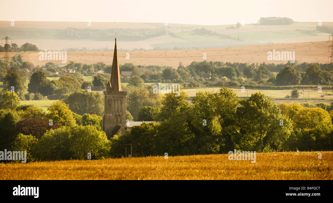 View over the downs with St.Mary's church spire at Bishops Canning in the foreground, Wiltshire,England,Great Britain, Stock Photo