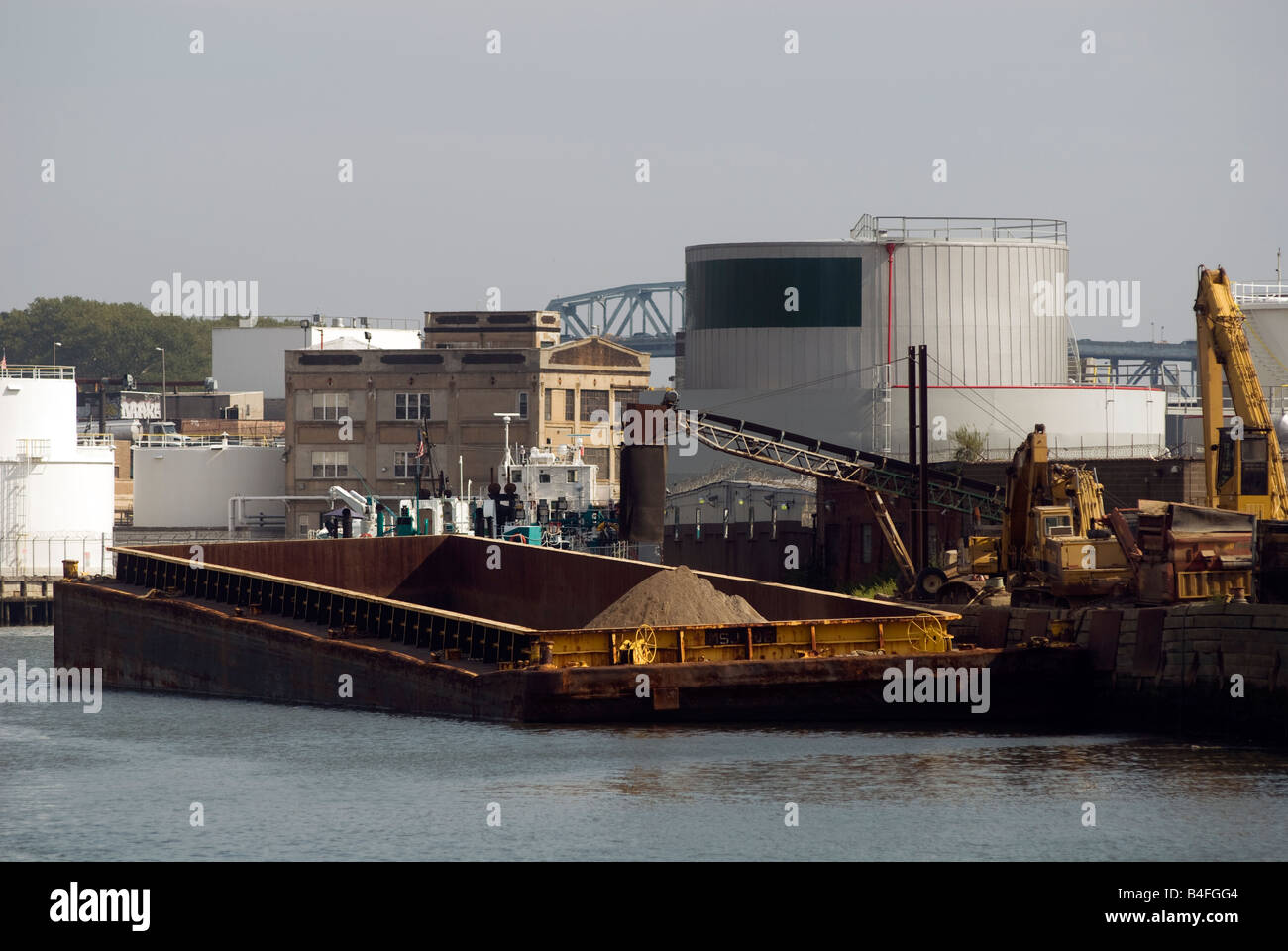 A barge moored along Newtown Creek an industrial waterway separating the boroughs of Brooklyn and Queens in New - Stock Image