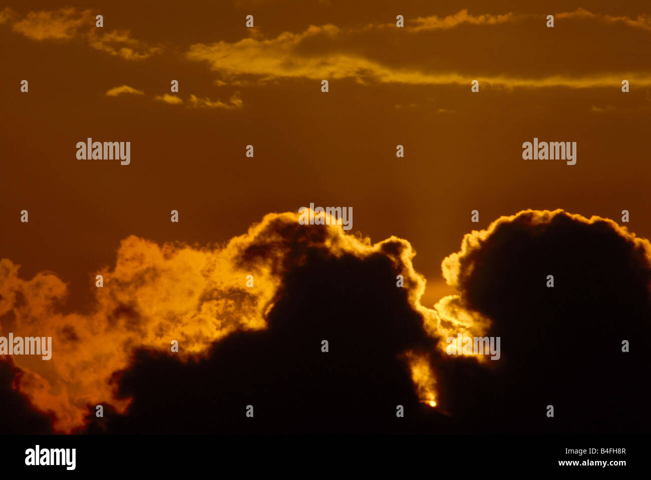 CLOUDS IN THE EVENING SKY - Stock Image