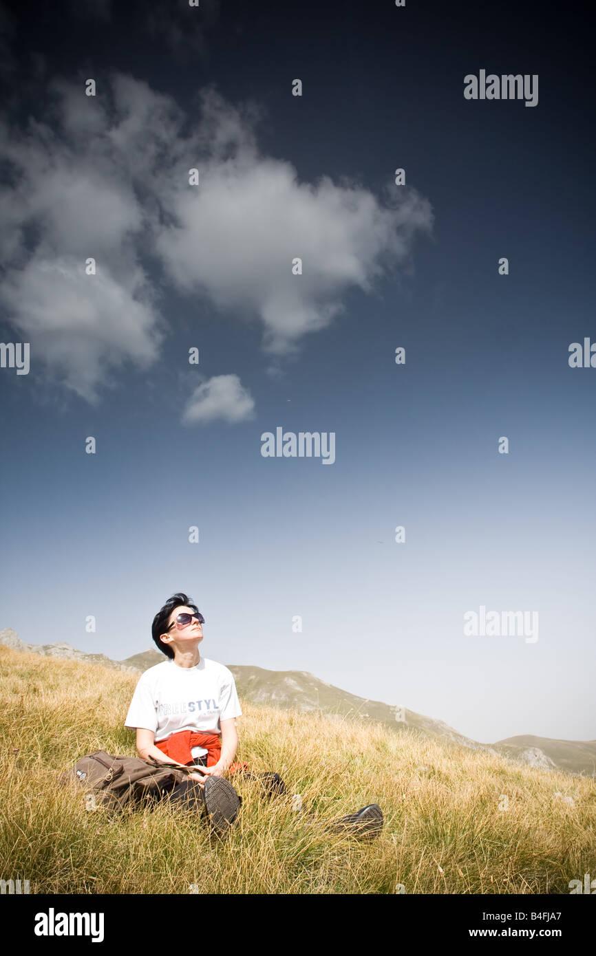 Young woman enjoying herself - Stock Image