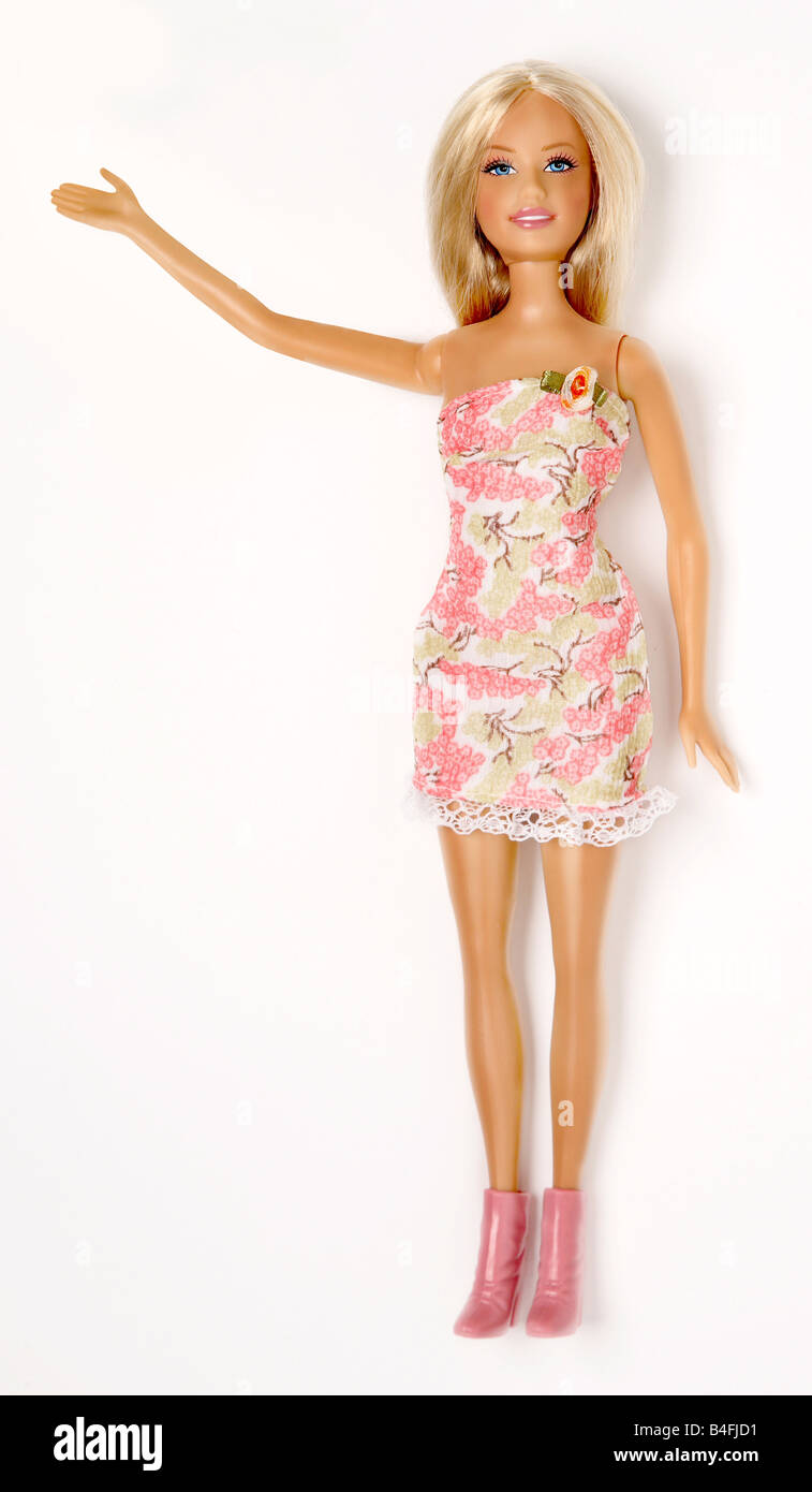 Barbie doll on a white background with one arm raised - Stock Image