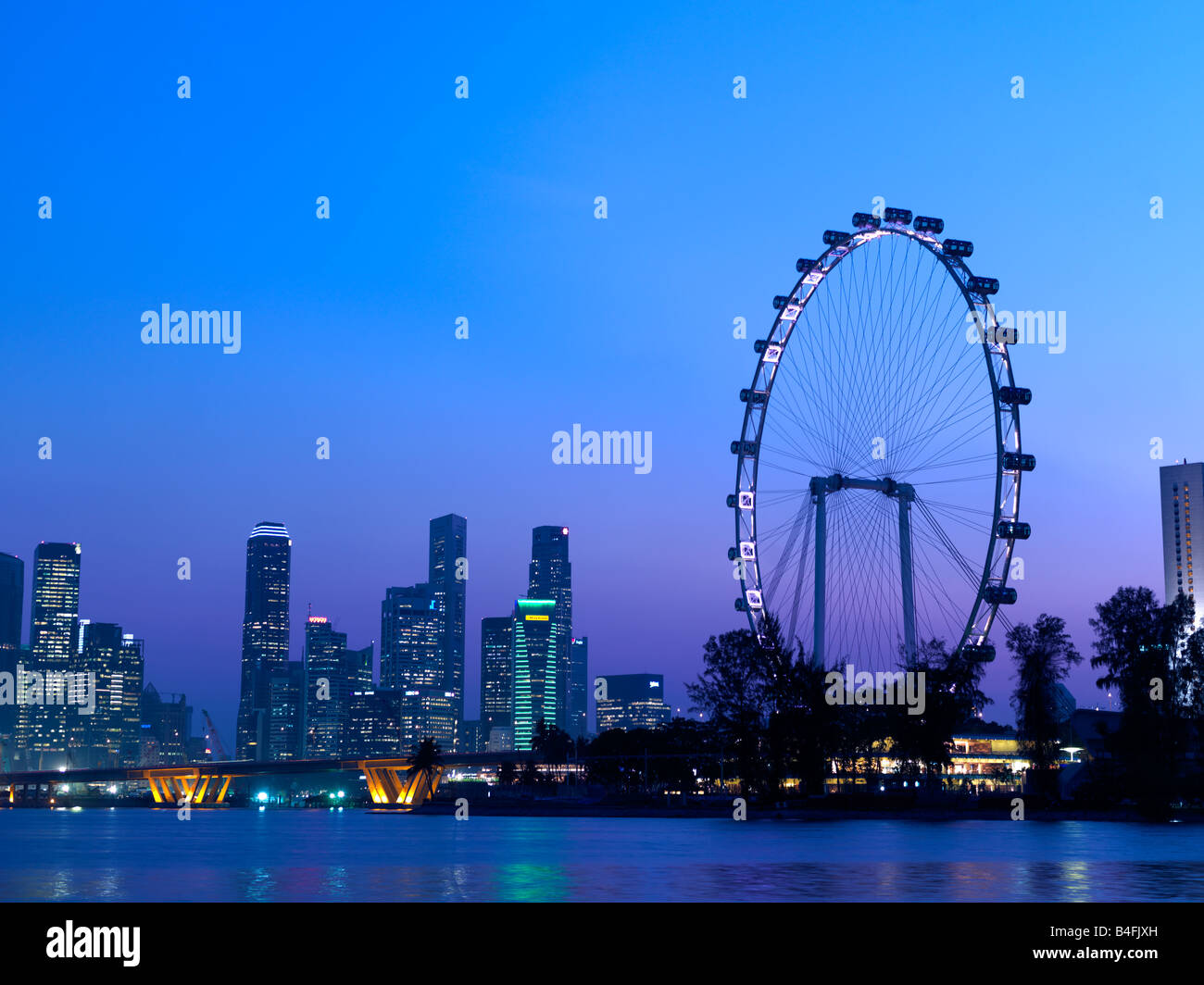 Singapore's skyline and the Singapore Flyer seen from Marina Bay. Stock Photo