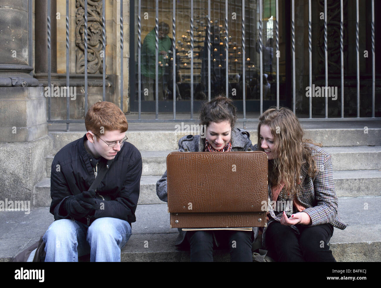 Teenagers looking into an open suitcase, Berlin, Germany - Stock Image