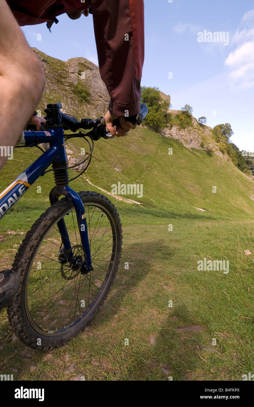 Mountain biking through Cavedale Castleton Peak District National Park Derbyshire England UK GB Stock Photo