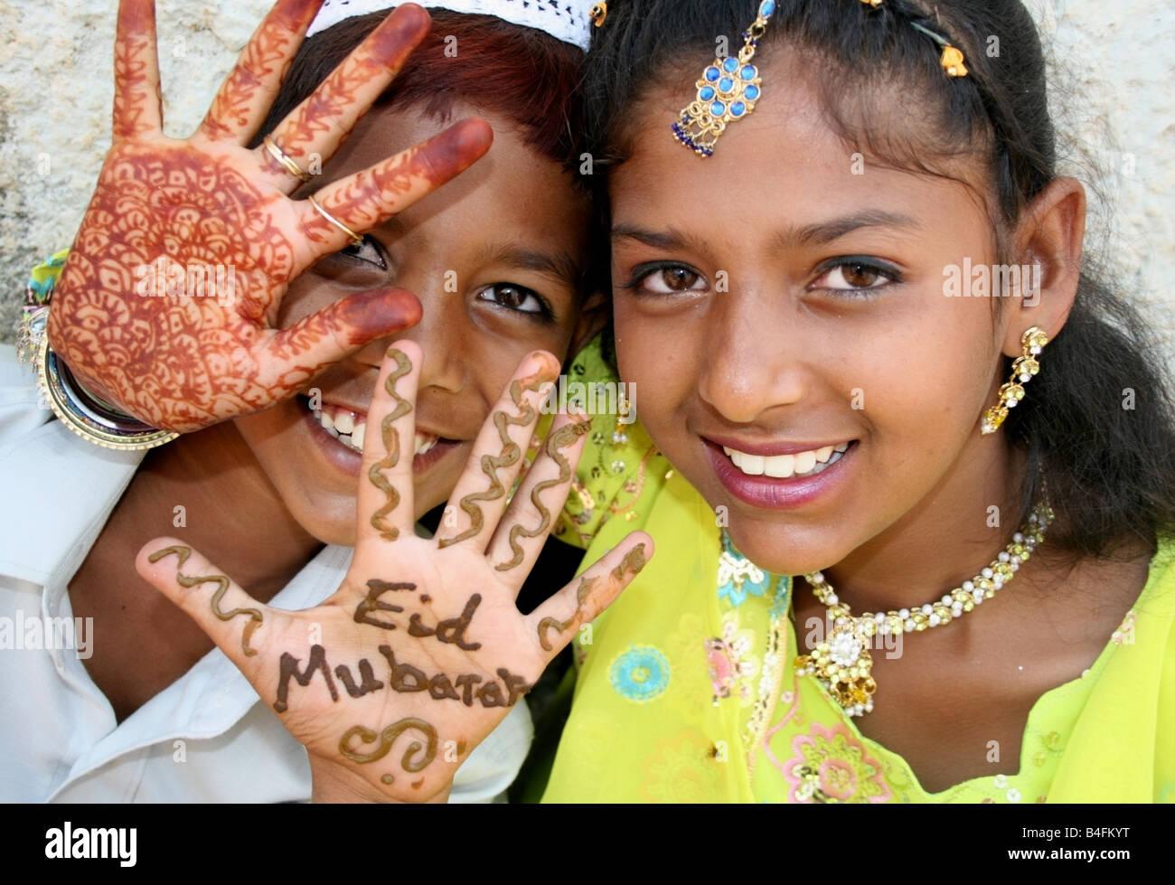 Moslem children with Eid Mubarak henna on their hands , Eid ul Fitr celebrations , India - Stock Image