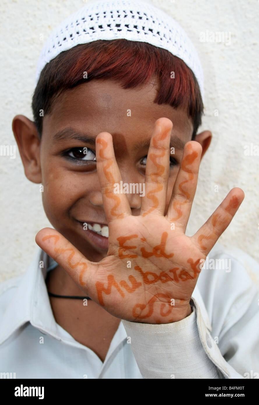 Moslem boy with Eid Mubarak henna on his hands , Eid ul Fitr celebrations , India - Stock Image